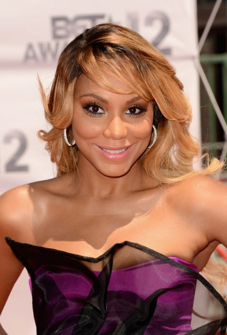 Tamar Braxton Hairstyles: Long Wavy Hairstyle with Bangs for African