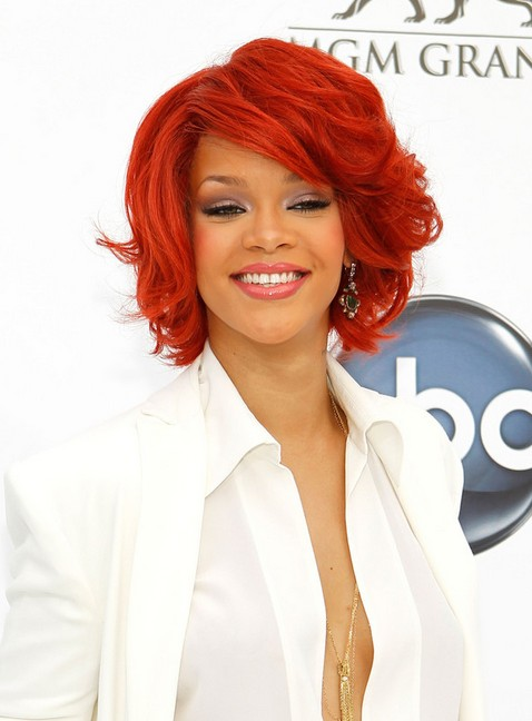 medium red bob hairstyle for curly hair rihanna red