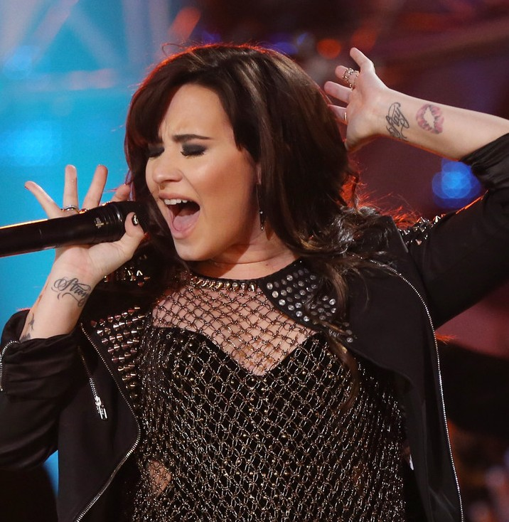Demi Lovato' Tattoos - Artistic Design Tattoo on Forearm