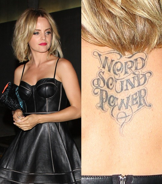 Mena Suvari' Tattoos - Upper Back Lettering Tattoo