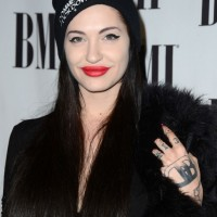 Porcelain Black's Tattoos - Lettering Tattoo on Back of Hand