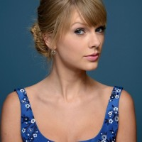 Taylor Swift Fishtail Bun Updo