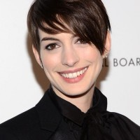 Anne Hathaway Short Haircut: Brunette Long Pixie Hair with Side Bangs