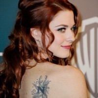 Alexandra Breckenridge's Tattoos - Lettering Tattoo on Upper Back