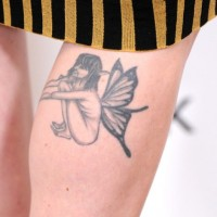 Alexandra Breckenridge's Tattoos - Wings Tattoo on Leg