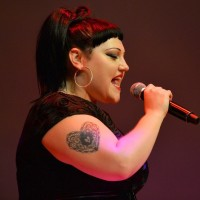 Beth Ditto's Tattoos - Heart Tattoo on Upper Arm