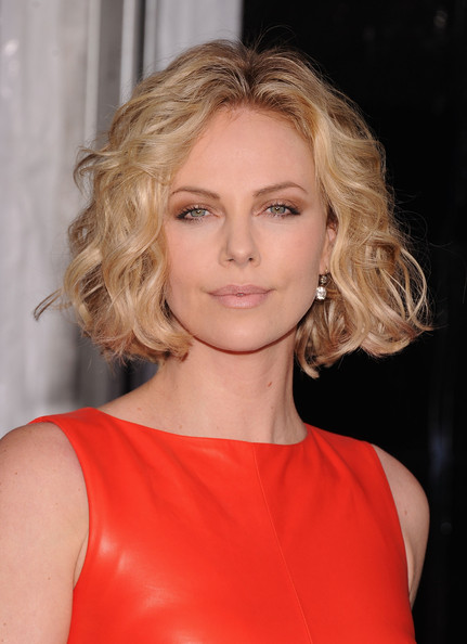 Charlize Theron Short Hairstyles: Jaw-length Bob with Voluminous textured Curls