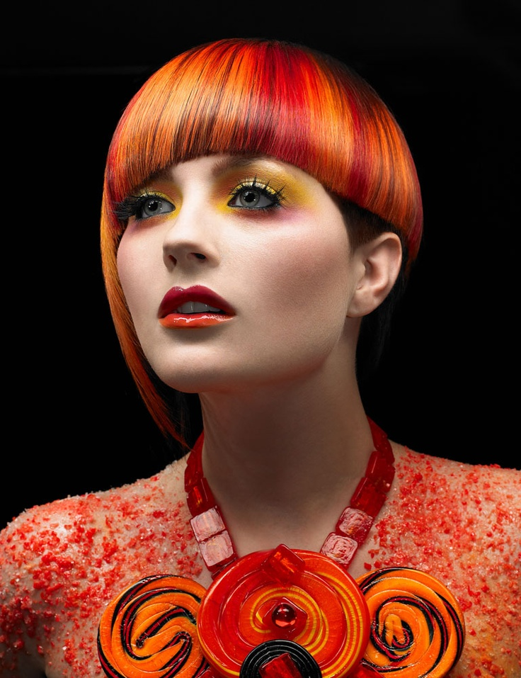 Colored Highlighted Short Hairstyle With Bangs