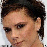 Victoria Beckham Short Haircut:Chopped Shaggy Brown Pixie Hair with Asymmetrical Parting