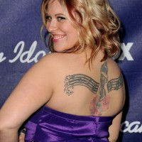 Erika Van Pelt's Tattoos - Artistic Design Tattoo on Upper Back