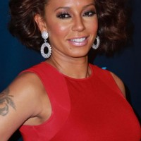Melanie Brown's Short Curly Hairstyle: Striking