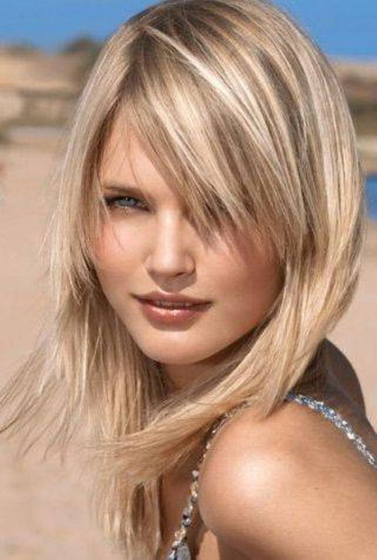 18 easy and flattering shaggy mid length hairstyles for women blond mid length shaggy hairstyle urmus Image collections