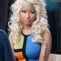 Nicki Minaj's Tattoos - Lettering Tattoo on Upper Arm