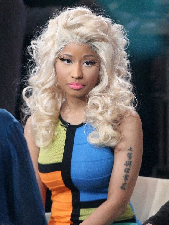 Nicki Minajs Tattoos Lettering Tattoo On Upper Arm