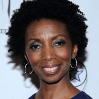 Sharon Washington's Short Curly Hairstyle: Natural and Neat