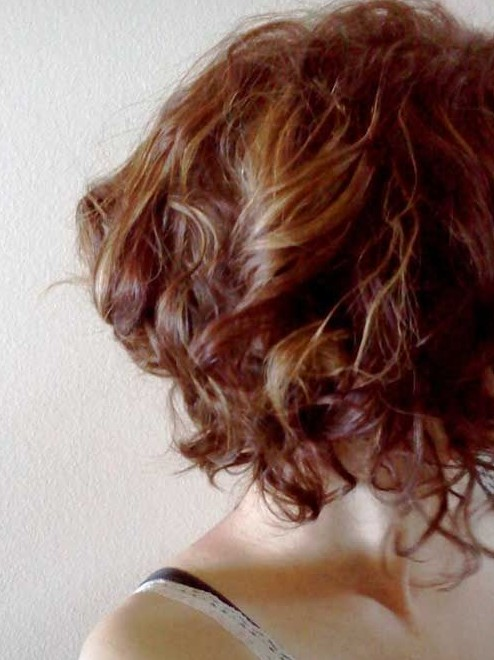 Side View of Chic Highlighted Short Curly Hairstyle