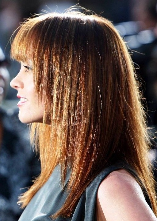 Side View of Long Brunette Hairstyle with Blunt Bangs