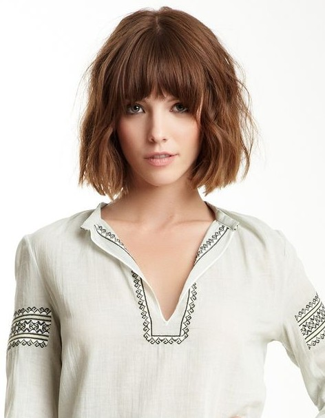 Tousled Curly Bob Hairstyle with Blunt Bangs