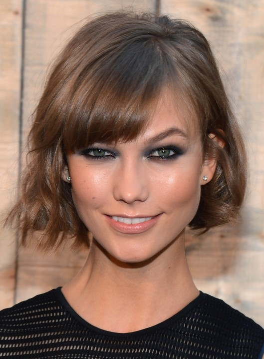 Hairstyles For Short Layered Hair With Side Bangs : Trendy Layered Short Bob Hairstyle with Bangs for 2014 /Getty Images