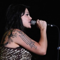 Vanessa Amorosi's Tattoos - Artistic Design Tattoo on Upper Arm
