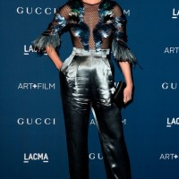 Amber Valletta Blue Gucci Jumpsuit Featuring a Mesh and Feather Bodice