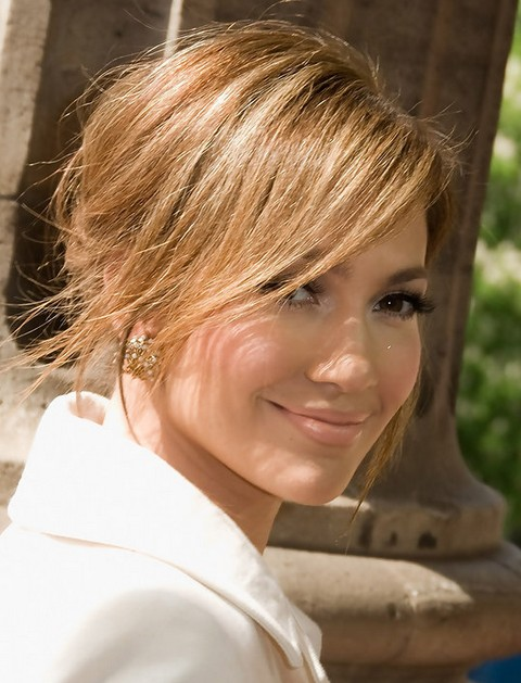Jennifer Lopez Hairstyles: Sunny Messy Updo with Side-swept Bangs