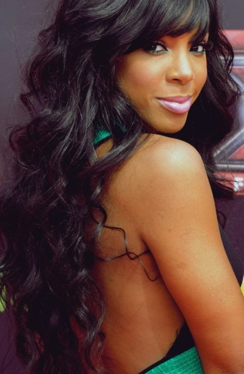 Kelly Rowland Hairstyles: Sexy Long Curls with Bangs