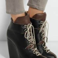 Lace-up leather wedge ankle boots.