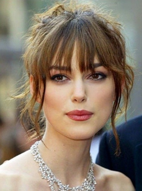 Messy Updo Hairstyle with Bangs for Long Face