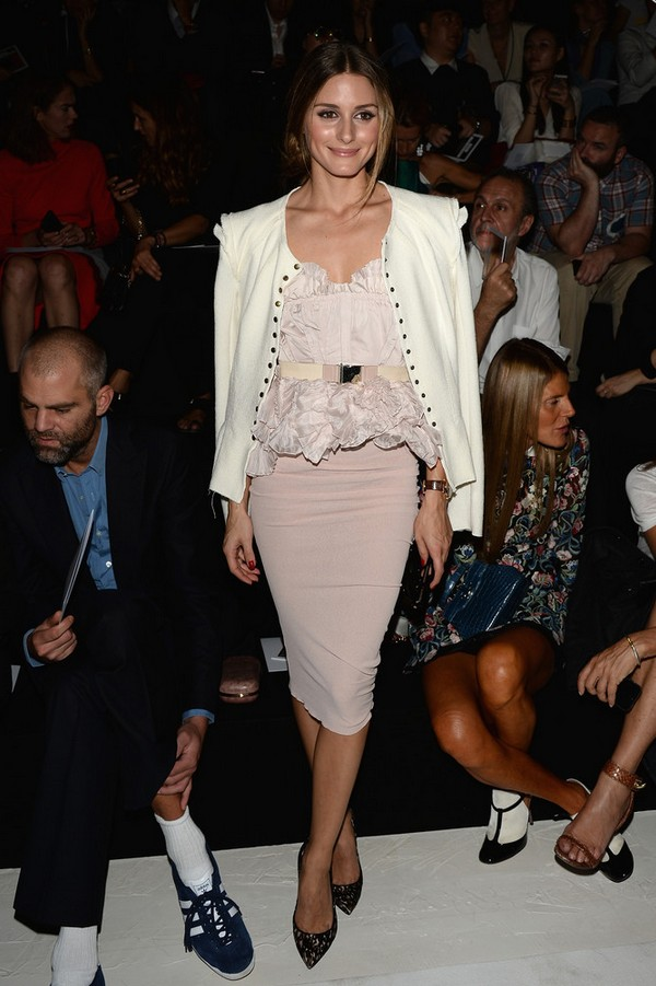 Olivia Palermo White Button-down Jacket Layered over a Ruffled Lilac Dress