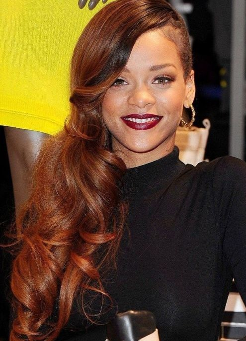 Rihanna Long Hairstyles: Red Curly Hair Style for 2014 /Getty Images