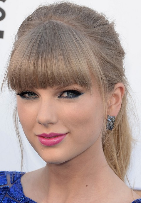 Taylor Swift Hairstyles: Blonde Ponytail with Blunt Bangs