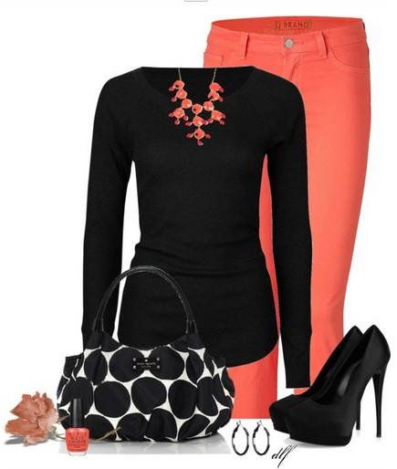 black knit top, orange skinnies and black pumps