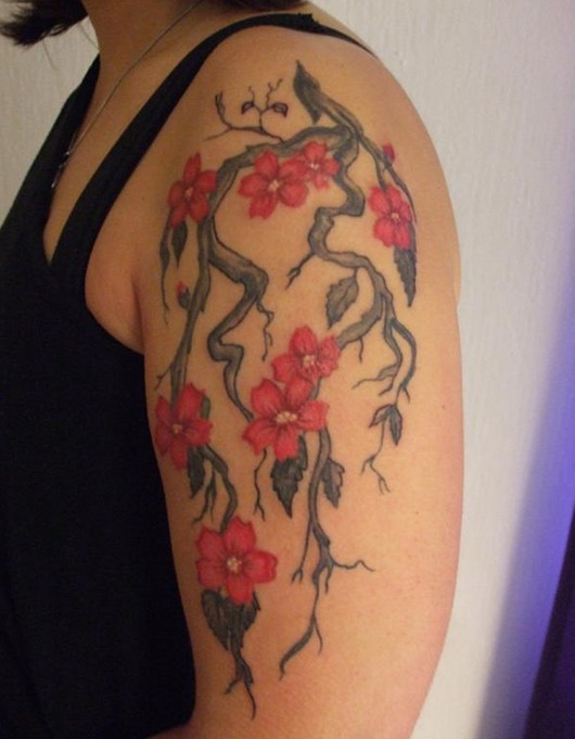 Cherry Tattoos Designs: Pretty blossom tattoo on the arm