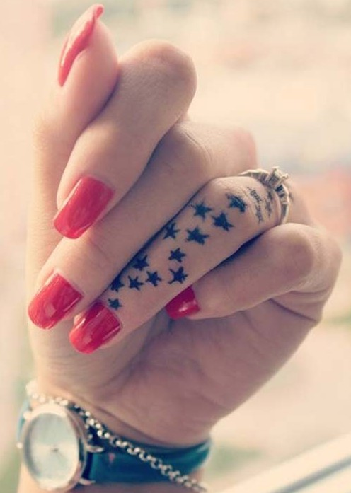 Cool small star tattoo designs: Finger tattoo ideas