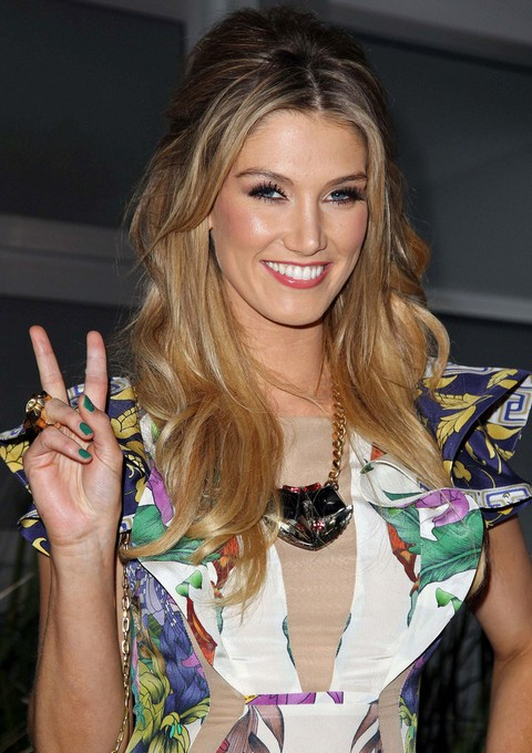 Delta Goodrem Hairstyles: Half-up Half-down Hairstyle with Bangs