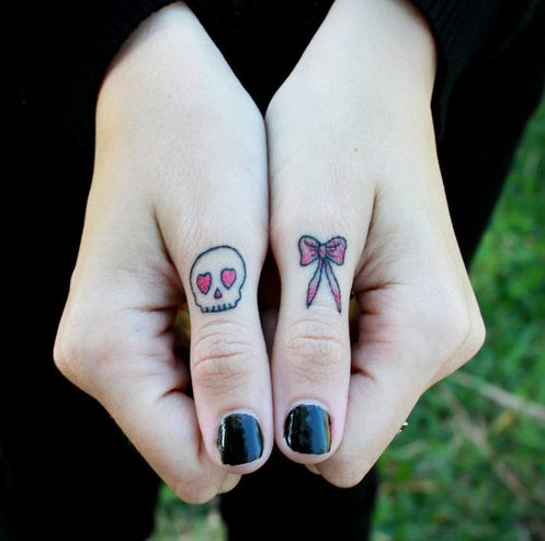 50 cool skull tattoos designs pretty designs for Finger tattoo ideas
