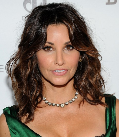 Gina Gershon Hairstyles: Center-parted Curls