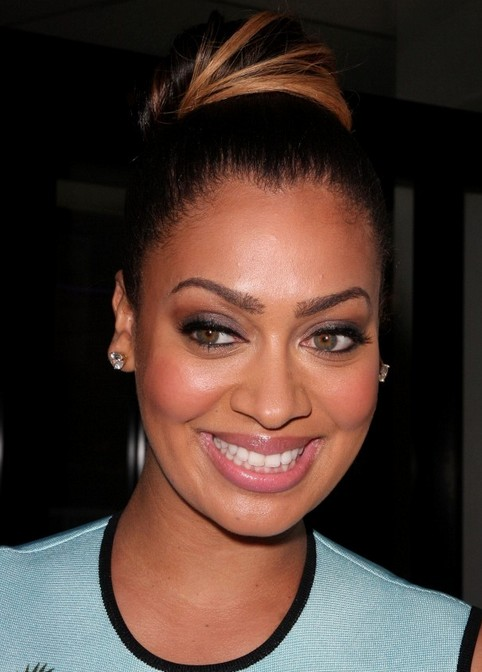 La La Anthony Long Hairstyle: Classic Bun with Highlights