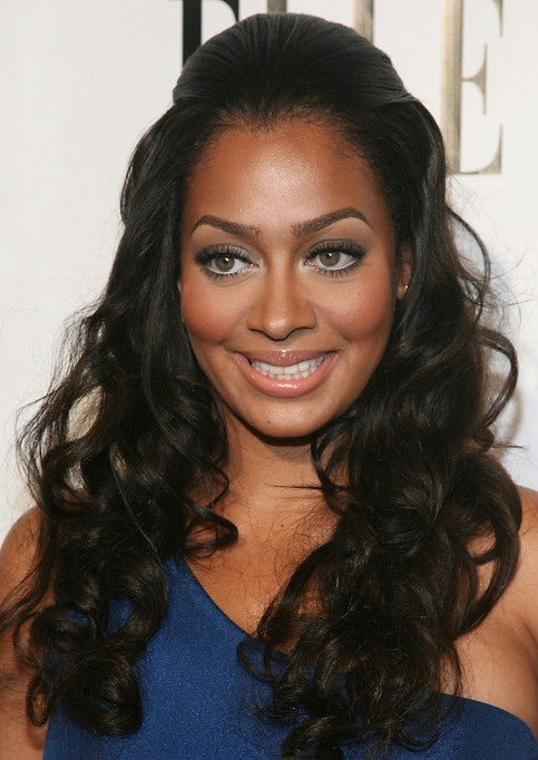 La La Anthony Long Hairstyle: Curls with Beehive Bangs