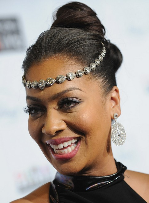 La La Anthony Long Hairstyle: Hair Knot with Accessory