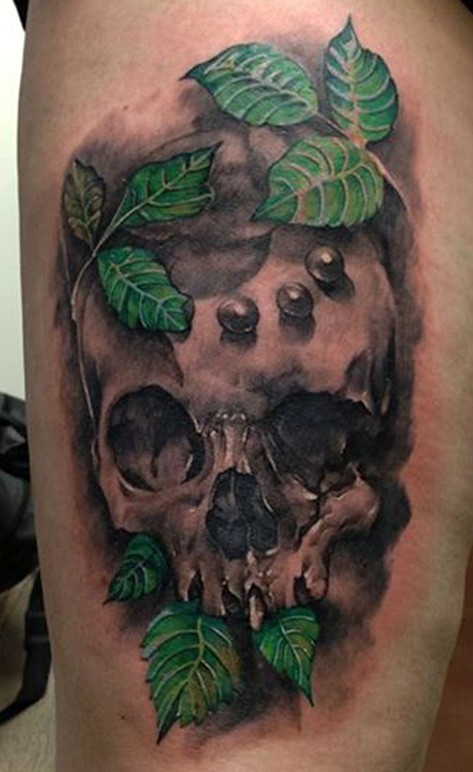 Leaf and skull tattoo