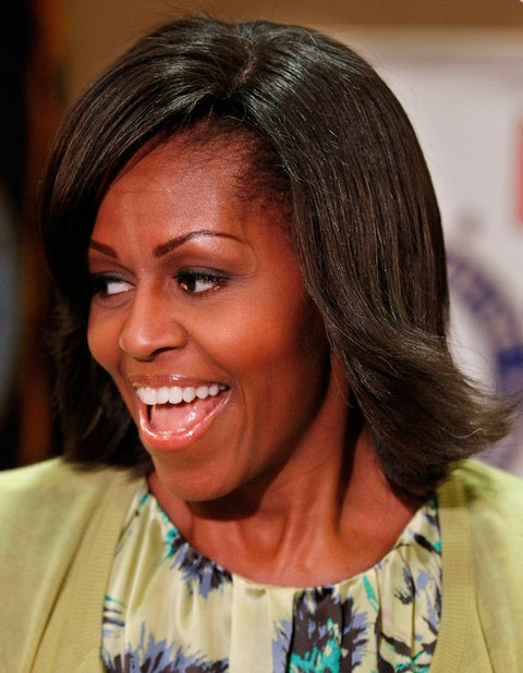 micro braid updo hairstyles : Michelle Obama Hairstyles: Feathered Flip Hairstyle View Image