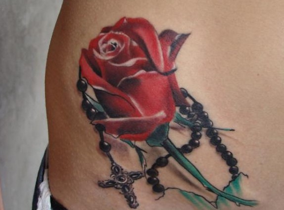 Rose and rosary tattoos