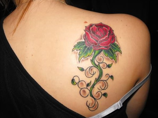 Rose tattoo on back shoulder