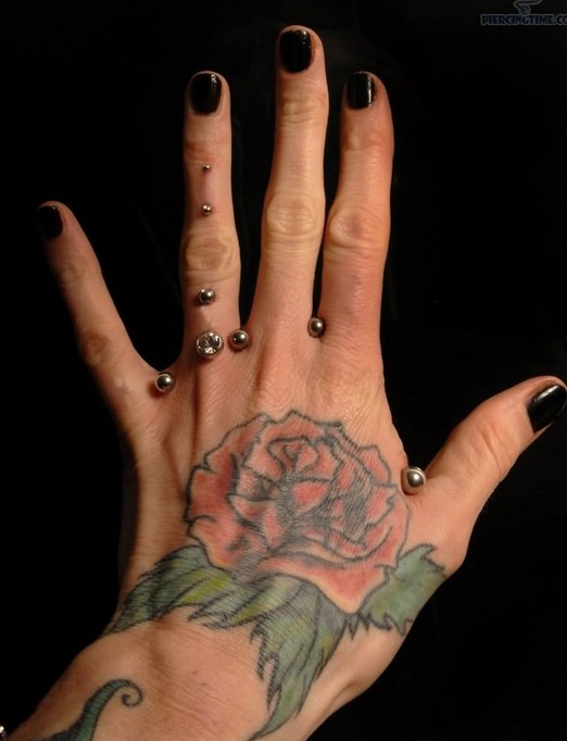Rose tattoo on hand: Women tattoos