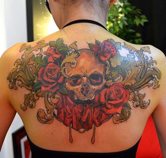 Skull and roses tattoo on black