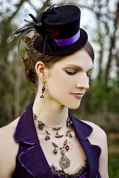 The Curly Wedding Hairstyle with a Black Decorative Hat