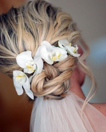 5 fantastic beach wedding hairstyles with flower decorations the messy twisted updo blond hair for beach wedding hairstyles junglespirit Images