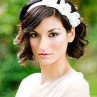 The Romantic Wedding Hairstyle with a Flowery Bridal Headband for Mid-length Curly Wavy Hair